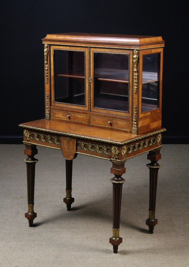 Lot 37 - A Louis XVI Style Inlaid Table à Écrire. The diagonal grained veneers inlaid with interlaced bands.