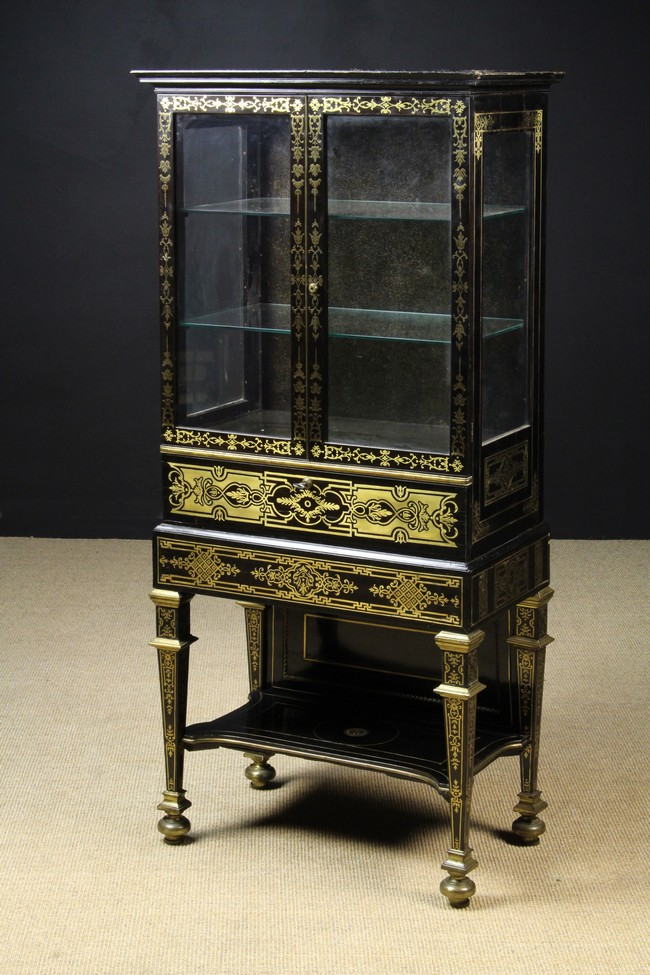 Lot 39 - A Small & Elegant Late 19th Century Ebonised Rosewood Cabinet decorated with elaborate brass inlay.