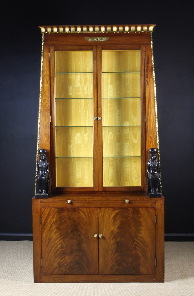 Lot 30 - A Tall & Exceptional Egyptianesque Mahogany Display Cabinet.