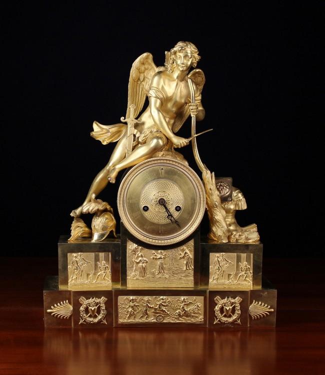 Lot 27 - An Empire Gilt Bronze Mantel Clock.