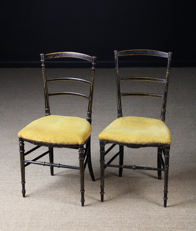 Lot 41 - A Pair of 19th Century Ebonised Side Chairs painted with gilt stringing.