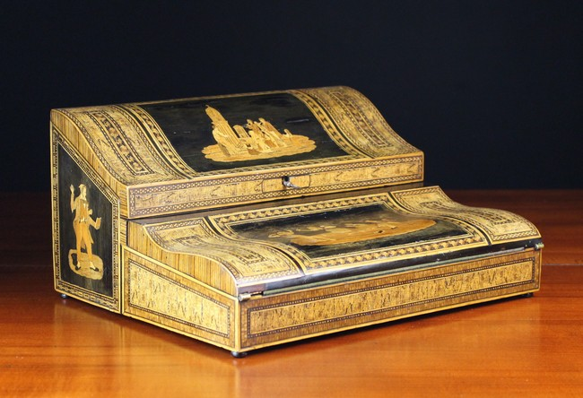 Lot 48 - A 19th Century Inlaid Italian Writing Slope decorated with figural panels framed by intricate