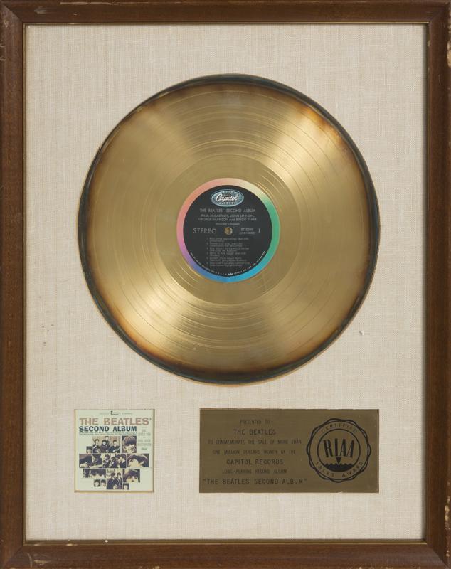RINGO STARR RIAA WHITE MATTE AWARD A framed \
