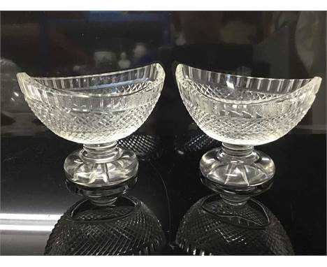 Pair of good quality Edwardian cut glass salts or bon bon dishes, of boat-shaped form, on circular pedestal bases, 10cm high
