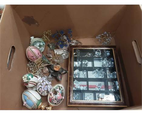 Two boxes of decorative items including eggs, Swarovski style glass ornaments and china