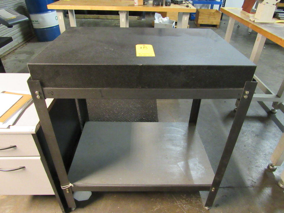 "24"" x 36"" x 4-1/4"" thick Granite table on black table stand, oad: 25"" x 37-1/2"" x 41"" high"