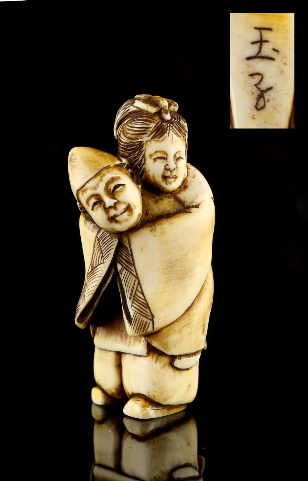 Lot 57 - The Ronald Hart Collection of Japanese Netsukes - a carved ivory netsuke modelled as a standing