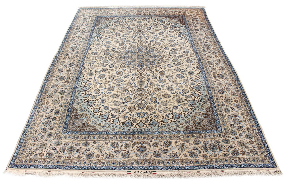 Lot 43 - Property of a gentleman - a fine Persian Isfahan part silk carpet, with ivory ground, signature