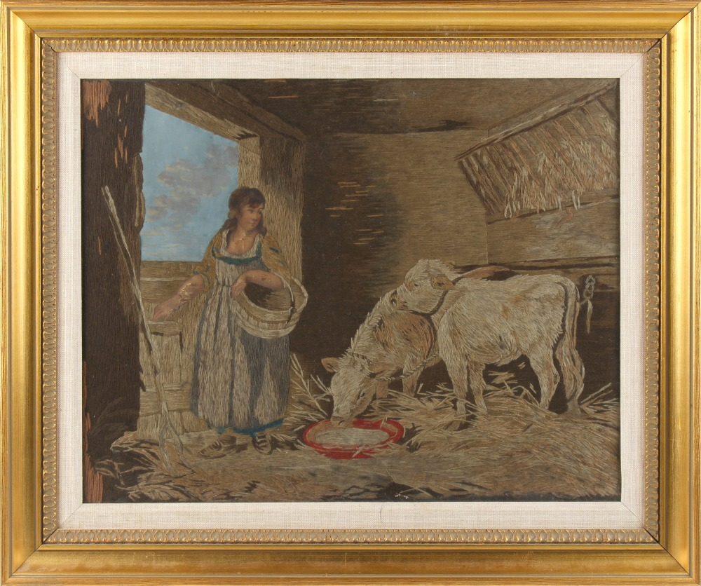 Lot 11 - Property of a deceased estate - a silk work picture depicting a maiden & two calves in a stable,