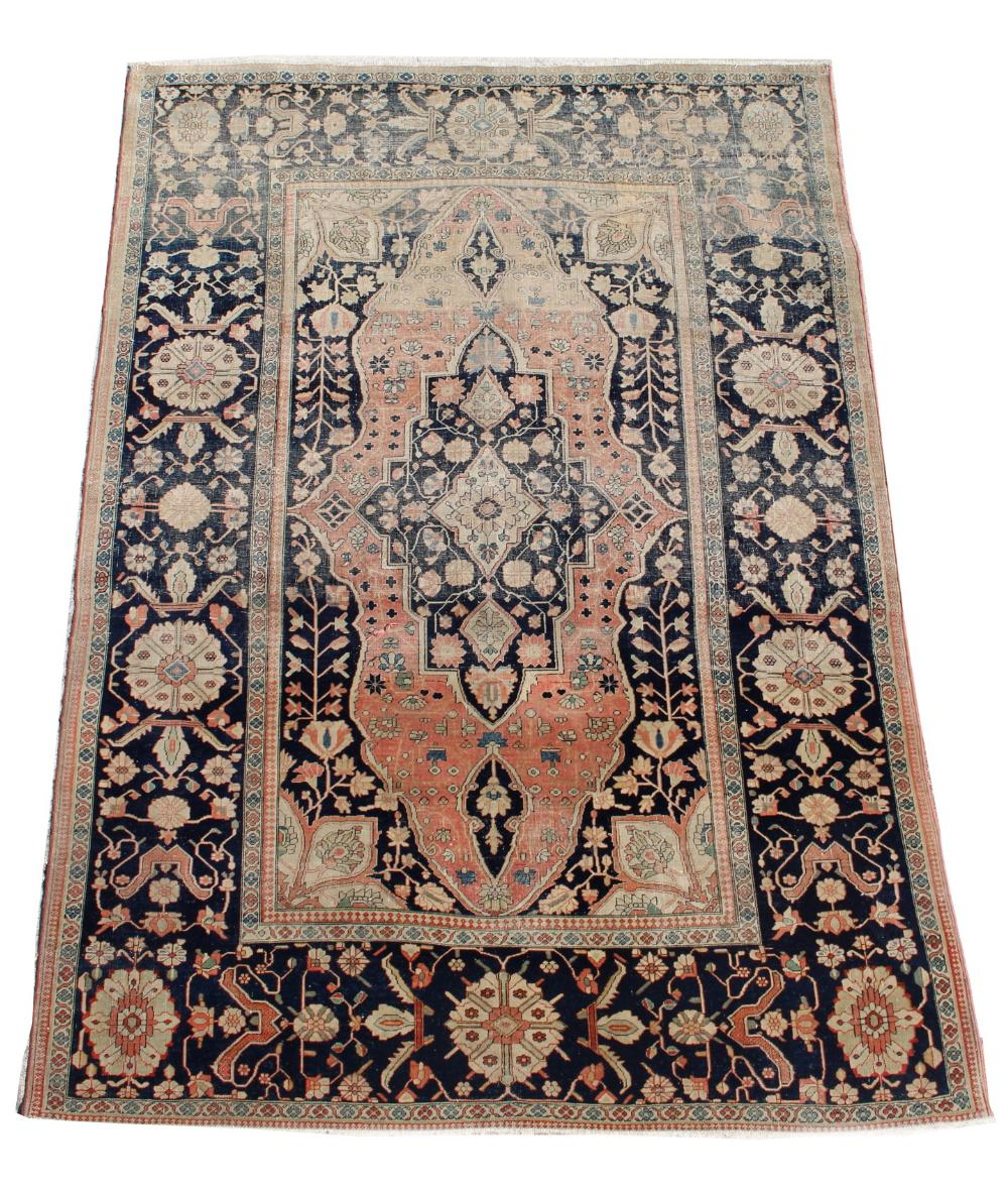 Lot 41 - Property of a lady - an antique Tabriz rug, worn, 75 by 51ins. (191 by 130cms.) (see illustration).
