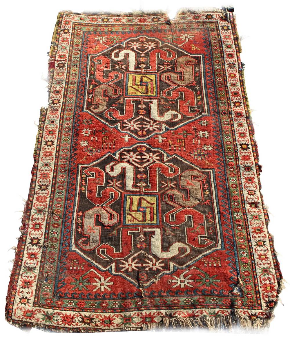 Lot 27 - Property of a gentleman - an antique Karabagh Chondzoresk rug, damages, 85 by 51ins. (216 by