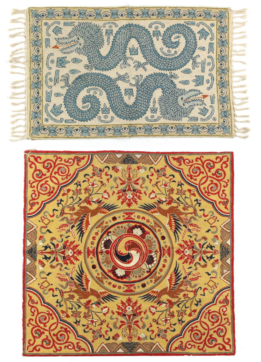 Lot 22 - Two crewel work rugs in the Chinese taste, the larger with four phoenixes on a yellow ground, the