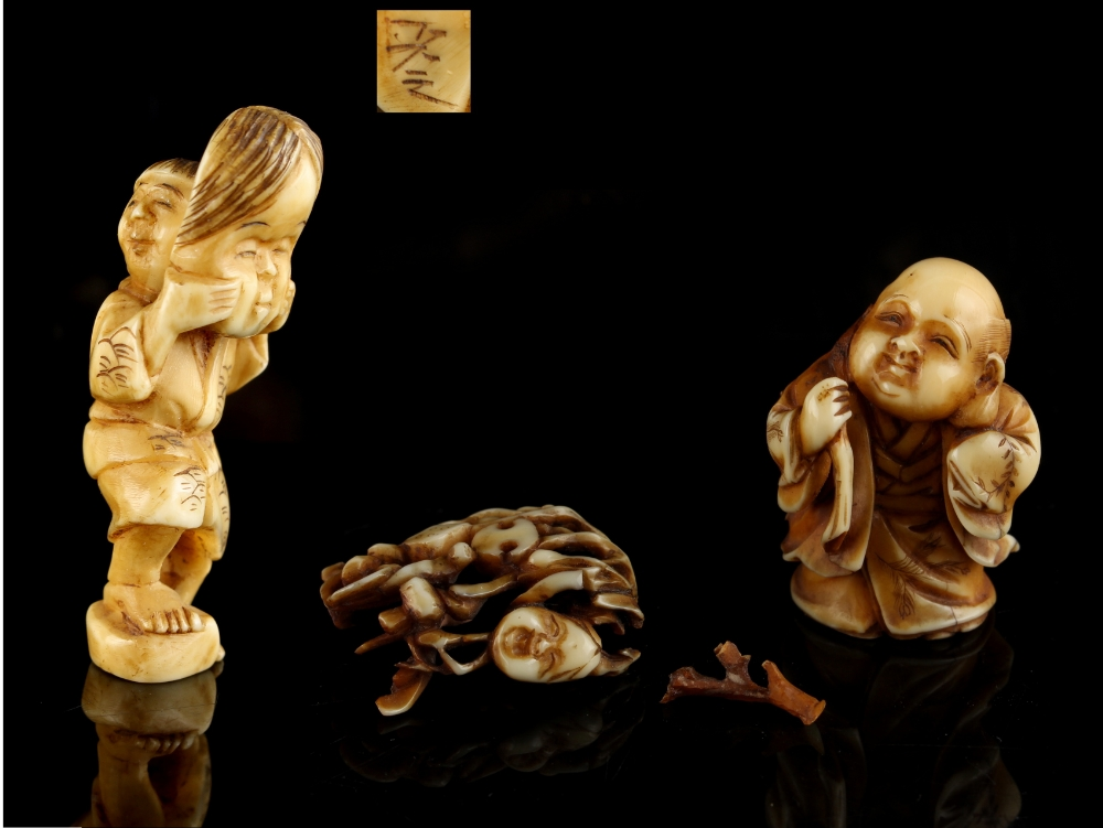 Lot 50 - The Gill Collection of Japanese Netsukes - a carved ivory netsuke modelled as a standing boy holding
