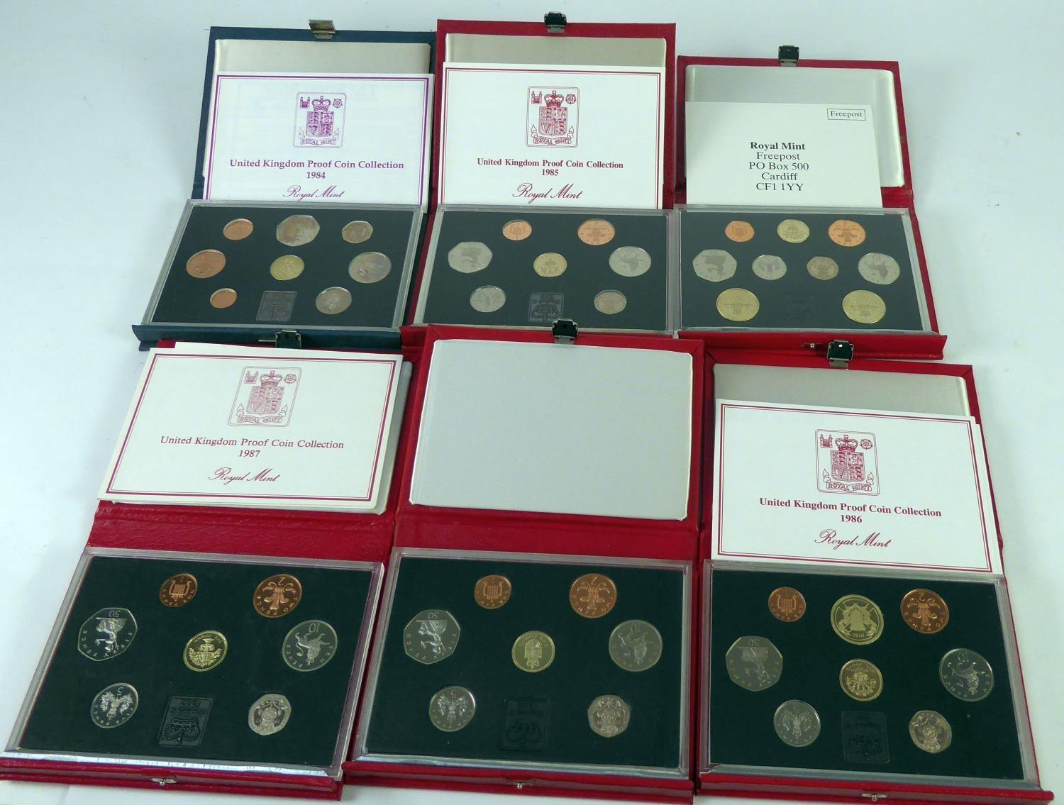 Lot 65 - ROYAL MINT ISSUED COMMEMORATIVE COIN SETS 1984-1989, in original boxes unused (6)