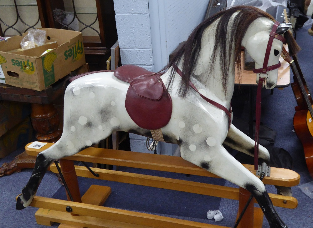 Lot 220 - RELKO MEDIUM SIZED HAND CARVED ROCKING HORSE, LATE 20TH CENTURY, white with black painted detail and