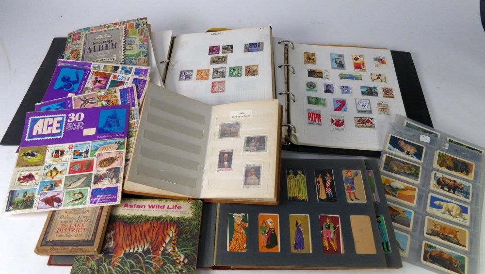 Lot 132 - SMALL MIXED LOT TO THREE BINDERS, CONTAINING ALL WORLD RANGES, also present a small selection of