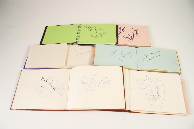 Lot 161 - SIX SMALL AUTOGRAPH BOOKS containing numerous entertainer's autographs including Chuck Berry, Pam