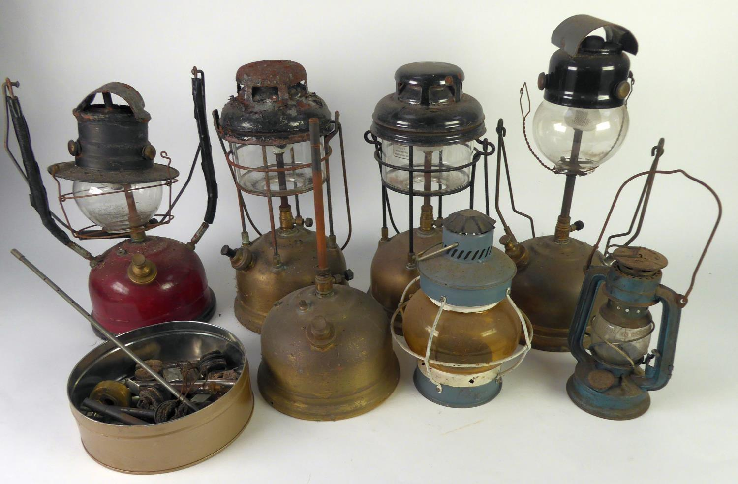 THREE TILLEY LAMPS with brass tanks, ANOTHER with red enamelled tank, two SMALL LANTERNS and part of