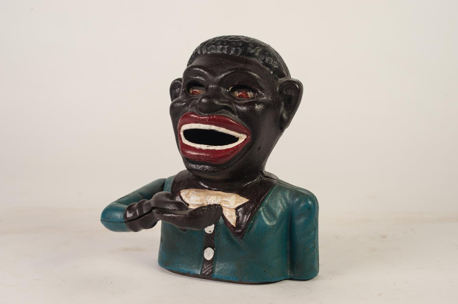 Lot 400 - EARLY TWENTIETH CENTURY CAST IRON 'JOLLY' MONEY BANK, of typical form but repainted, the base