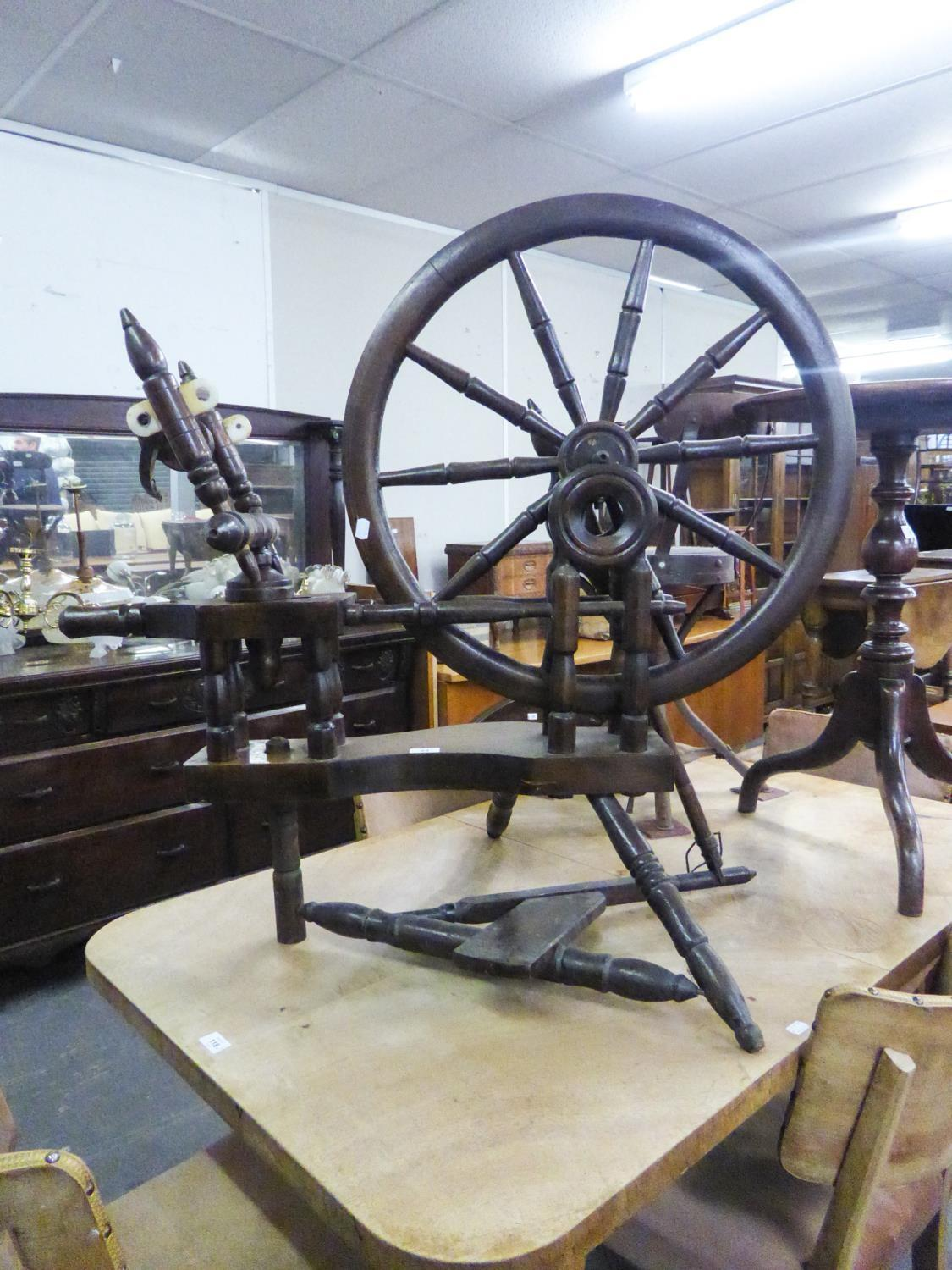 Lot 445 - AN ANTIQUE LARGE SPINNING WHEEL