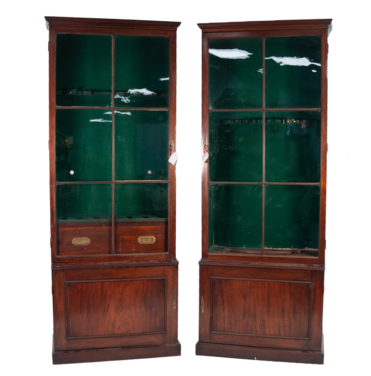 Lot 180 - PAIR OF GEORGE III MAHOGANY SHOTGUN AND FISHING ROD CABINETS, each with moulded cornice above a