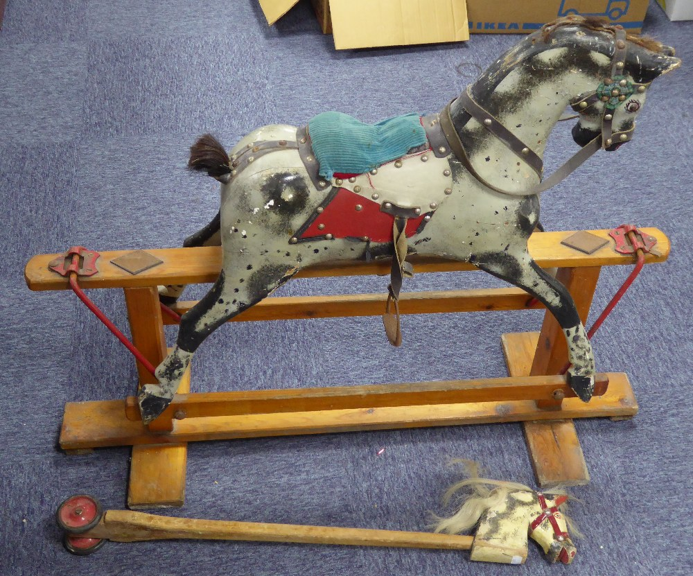 Lot 221 - MID CHILD'S TRIANG MEDIUM SIZED CARVED AND PAINTED WOOD PLATFORM ROCKING HORSE, with leather tack