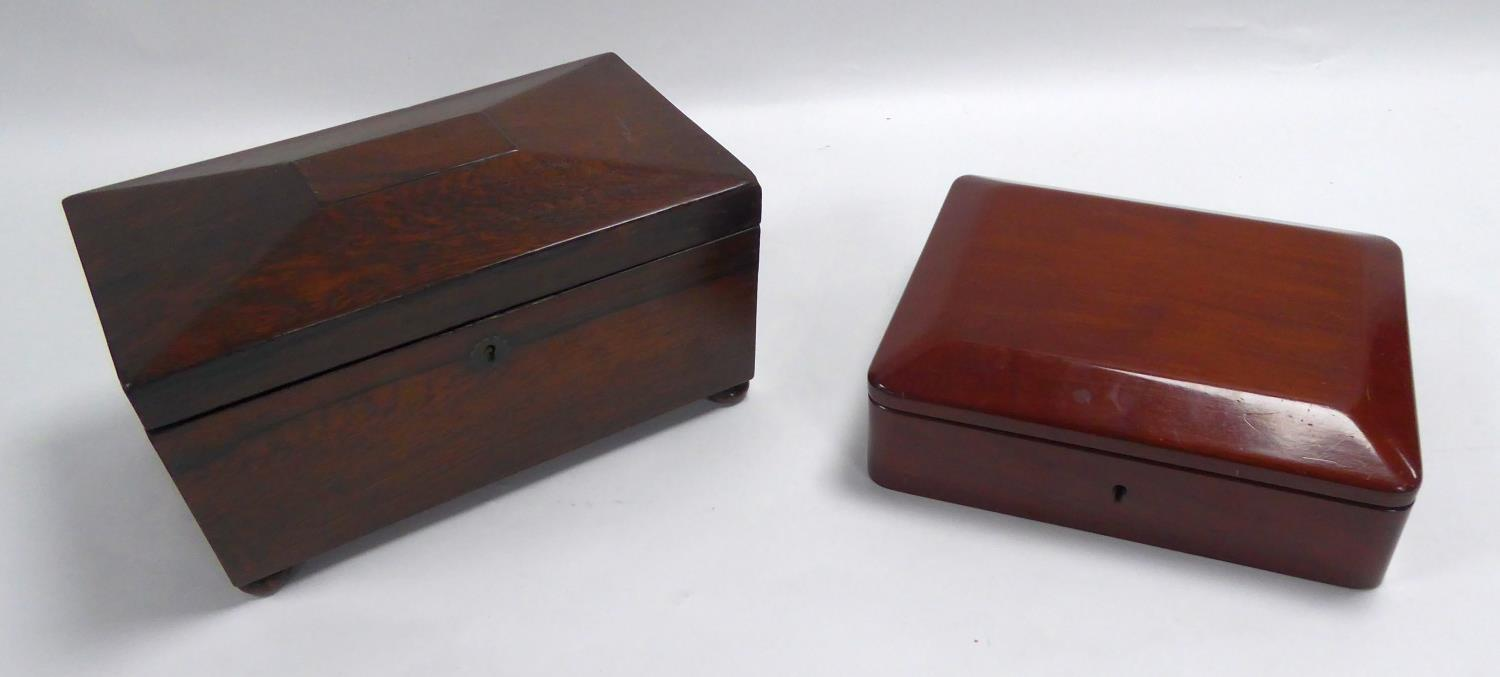 Lot 370 - NINETEENTH CENTURY ROSEWOOD TEA CADDY, of sarcophagus form with bun feet, the interior with a pair