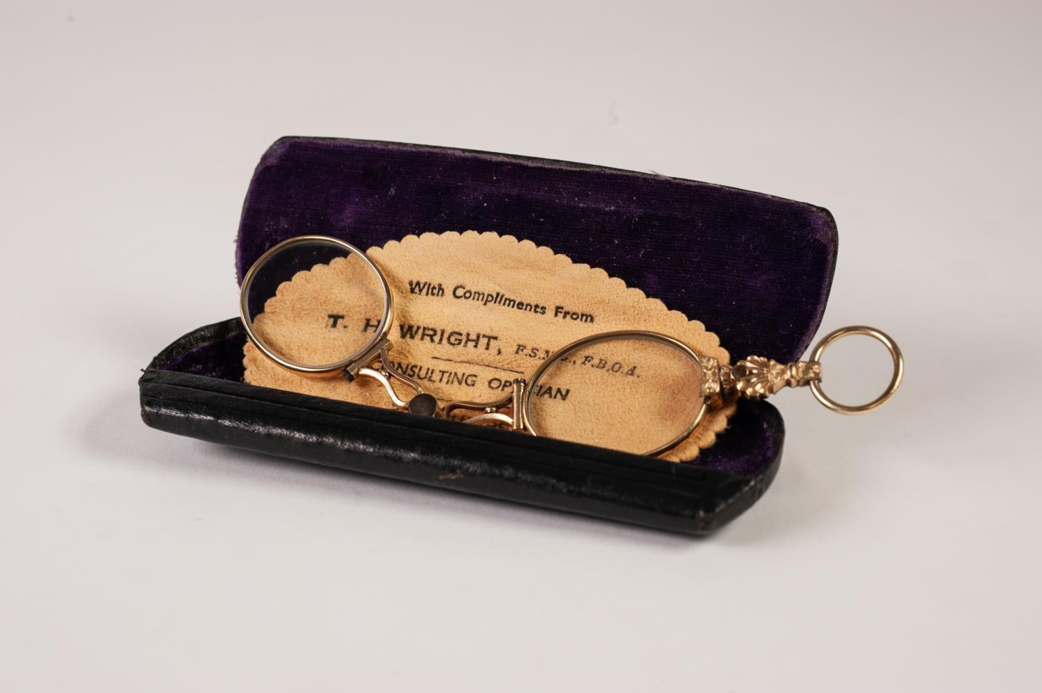 Lot 402 - PAIR OF EARLY TWENTIETH CENTURY GILT METAL LORGNETTE GLASSES, with anthemion and flowerhead shaped