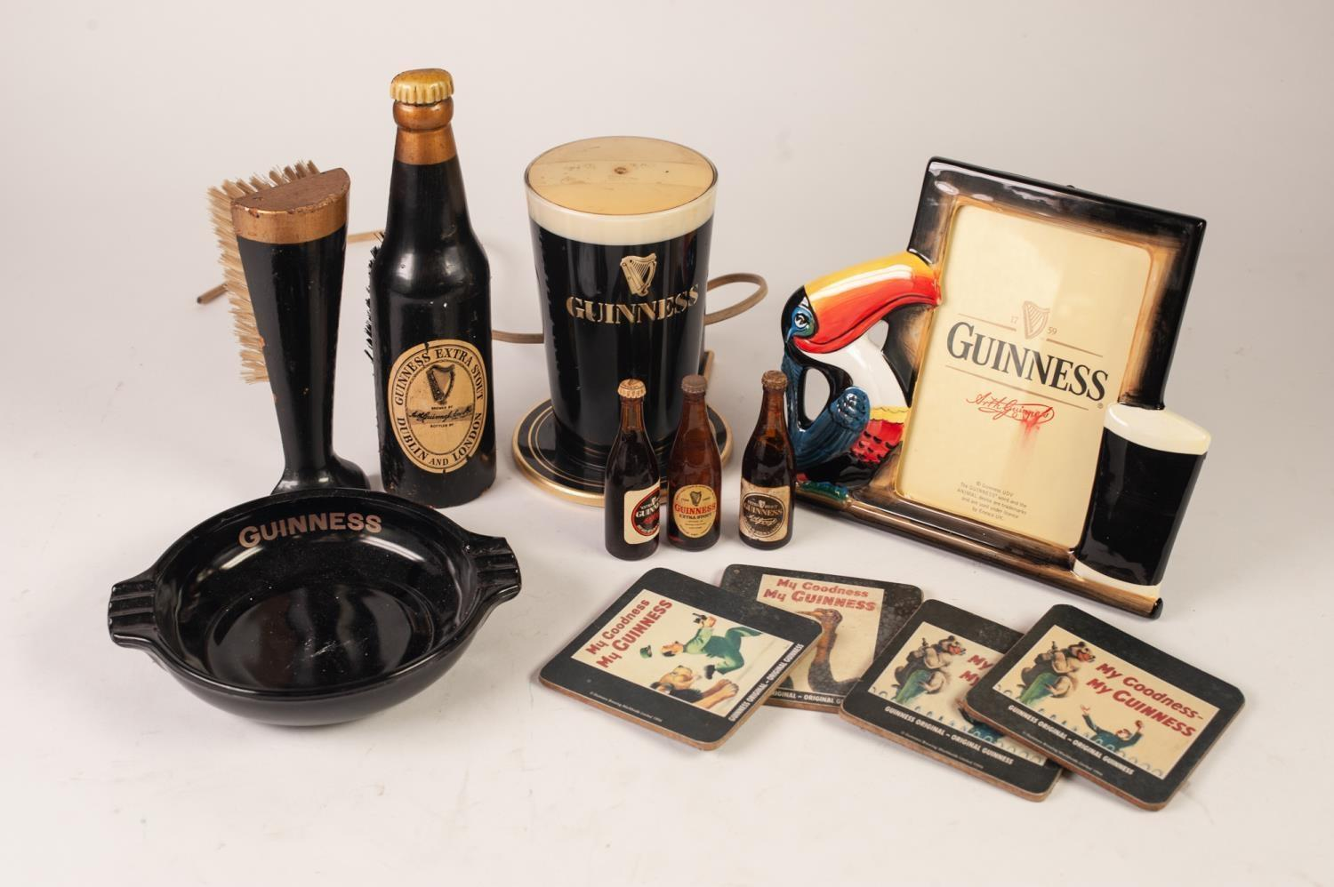 Lot 426 - GUINNESS RELATED COLLECTABLES to include; pottery Toucan easel photo frame with oblong aperture,