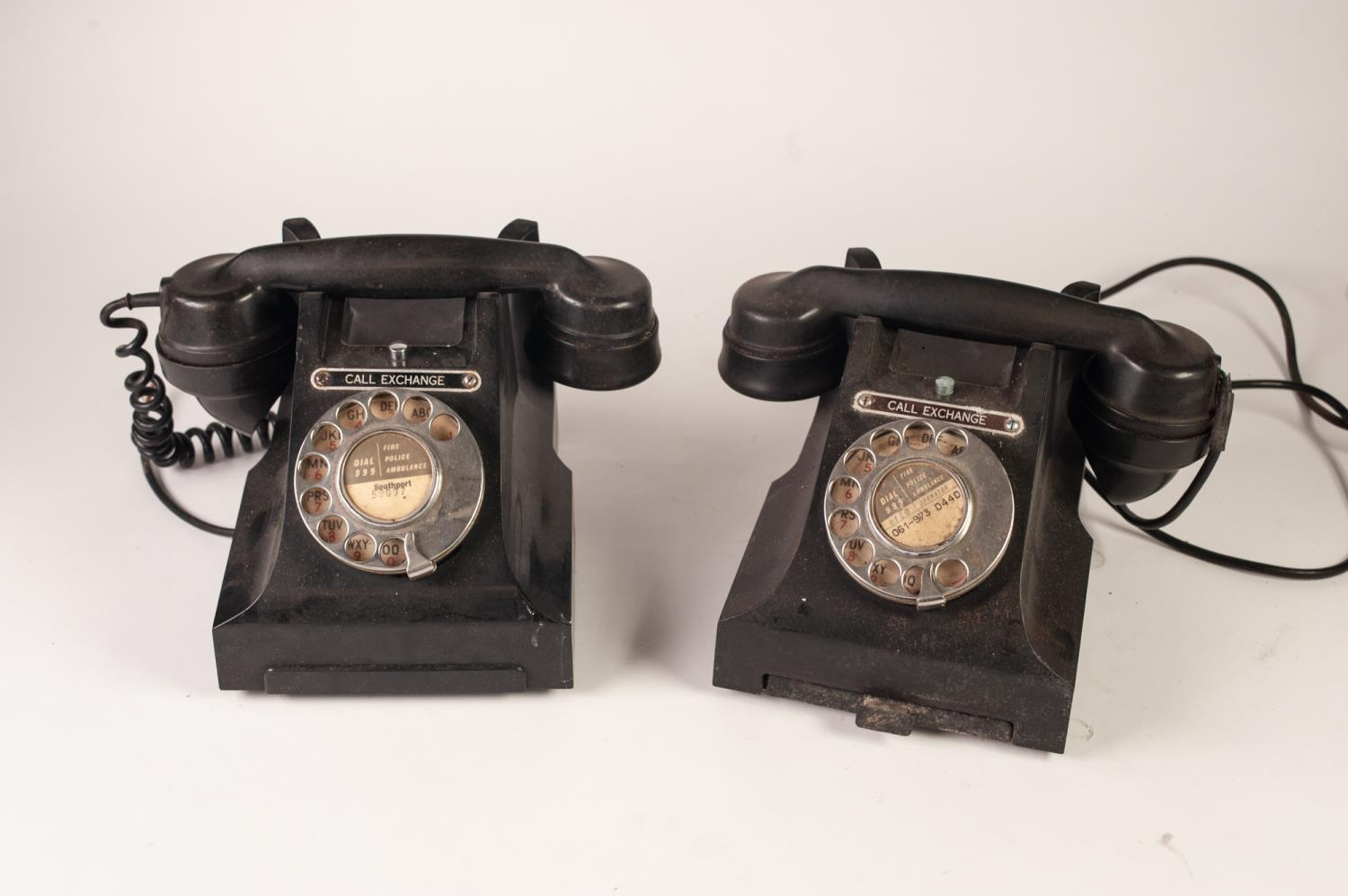 Lot 423 - TWO G.P.O. BLACK BAKELITE CRADLE TELEPHONRES, top mounted with chromed metal call exchange buttons