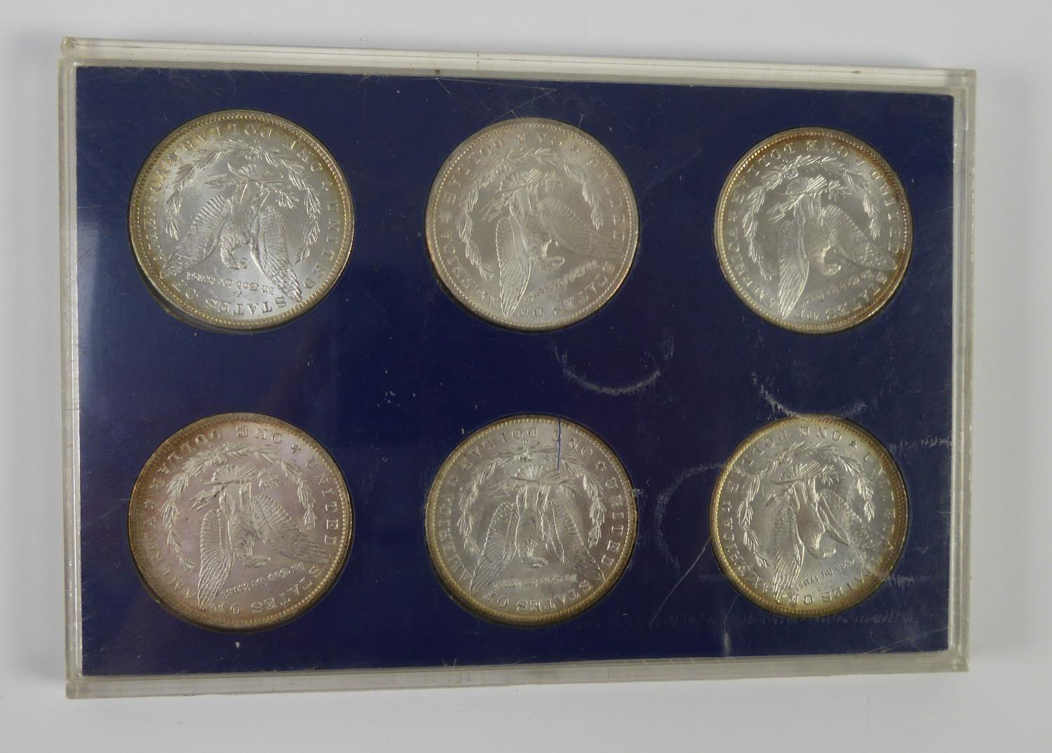 Lot 29 - SIX UNITED STATES OF AMERICA 19th CENTURY SILVER DOLLAR COINS, 1880, 81, 82, 83, 84 and 85, each