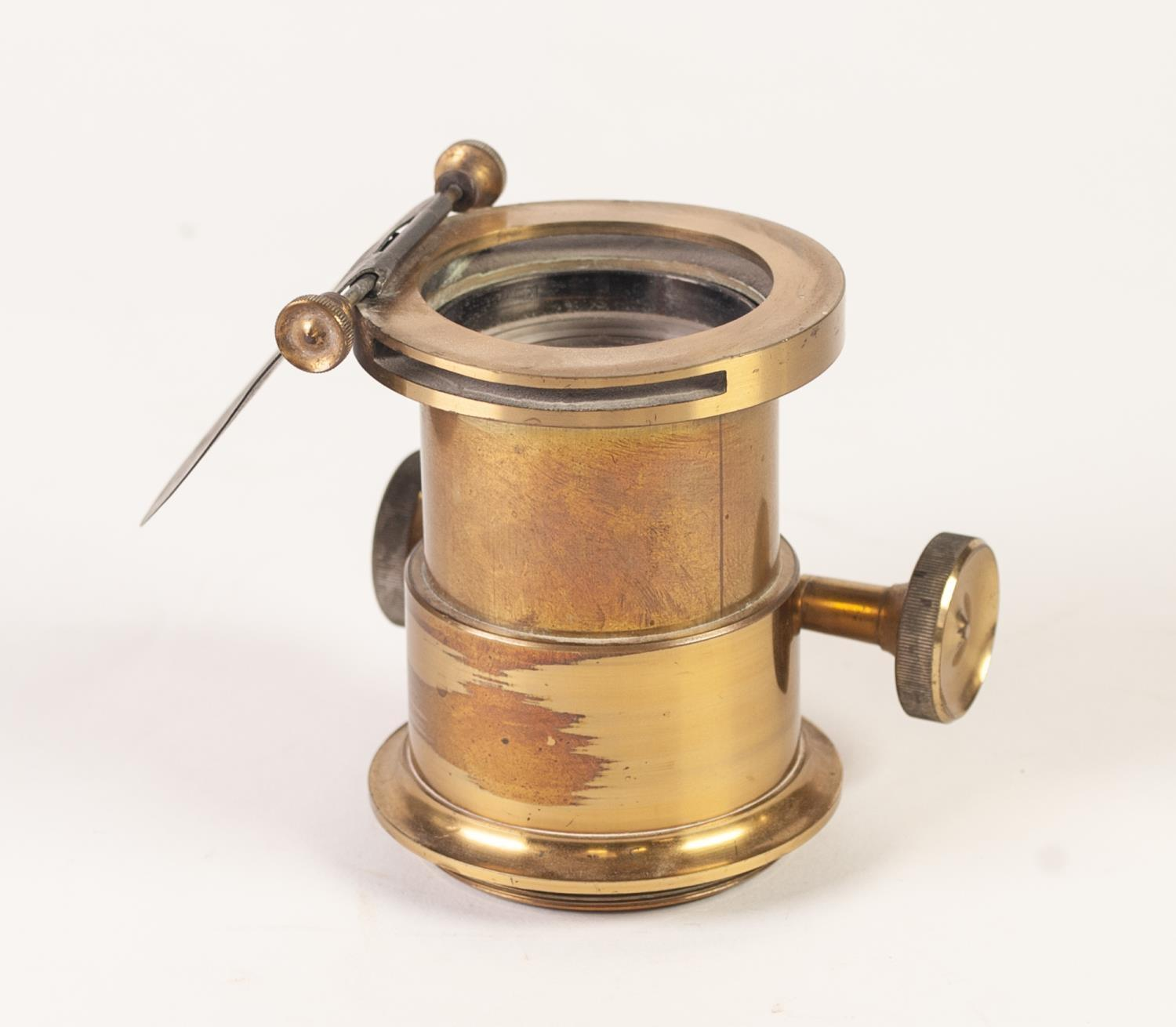 "Lot 193 - NINETEENTH CENTURY LACQUERED BRASS MAGIC LANTERN LENS, having 2""(5cm) diameter, main lens with"