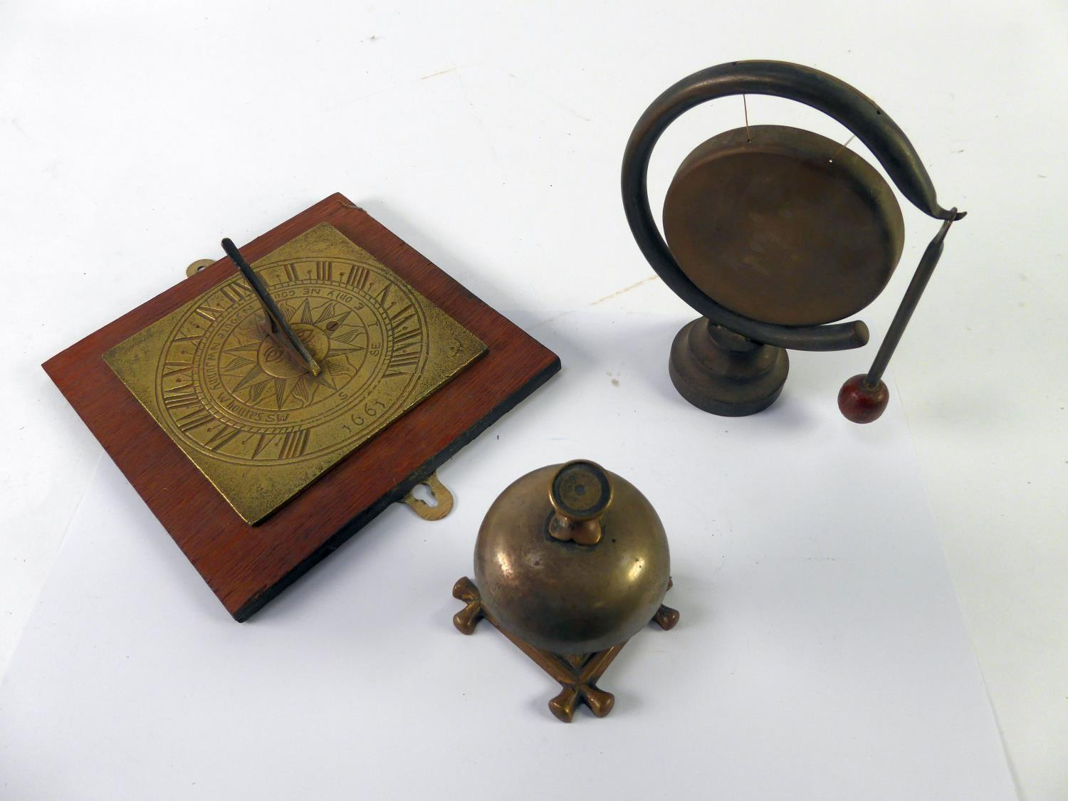 """Lot 460 - OLD BRASS COUNTER BELL; a small metal GONG and BEATER, 7"""" (17.7cm) high and a metal square SUNDIAL"""