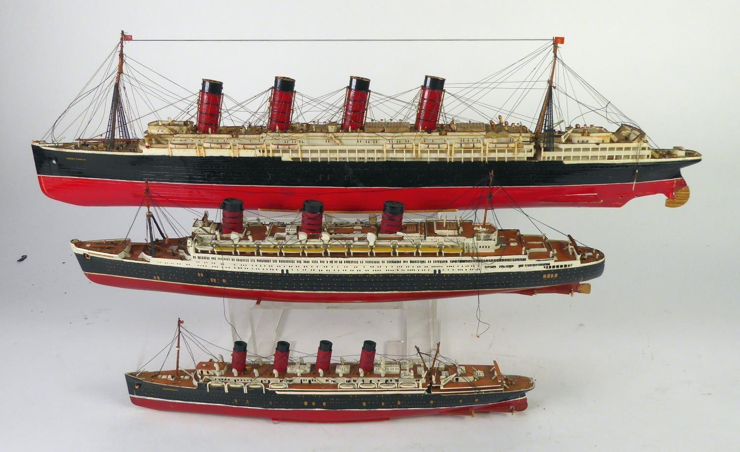 """Lot 451 - THREE WELL CONSTRUCTED AND PAINTED PLASTIC SHIP MODELS viz the 'Lucitania', 27"""" (68.5cm) long, '"""