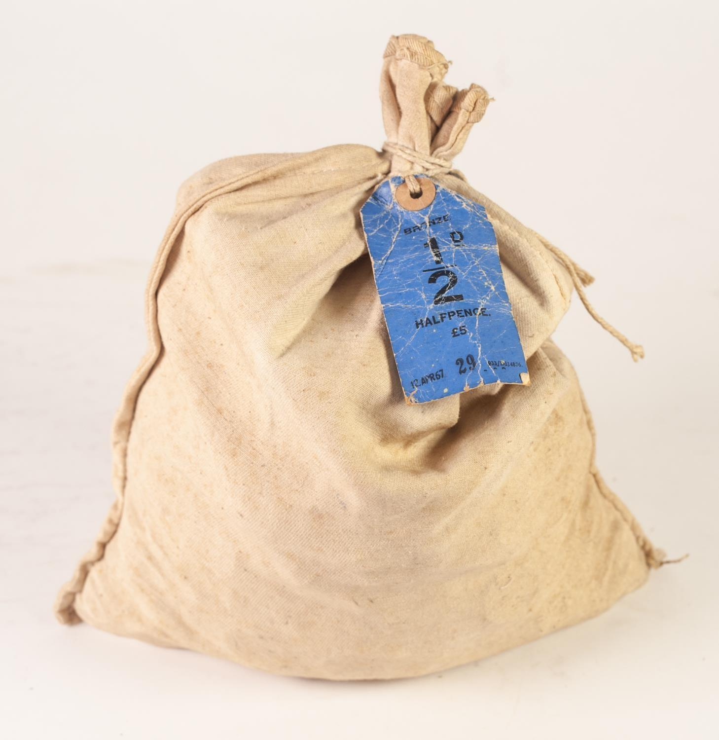 Lot 3 - CREAM CLOTH BANK BAG CONTAIING FIVE POUNDS WORTH OF UNCIRCULATED 1967 HALF PENNY COINS, tied with