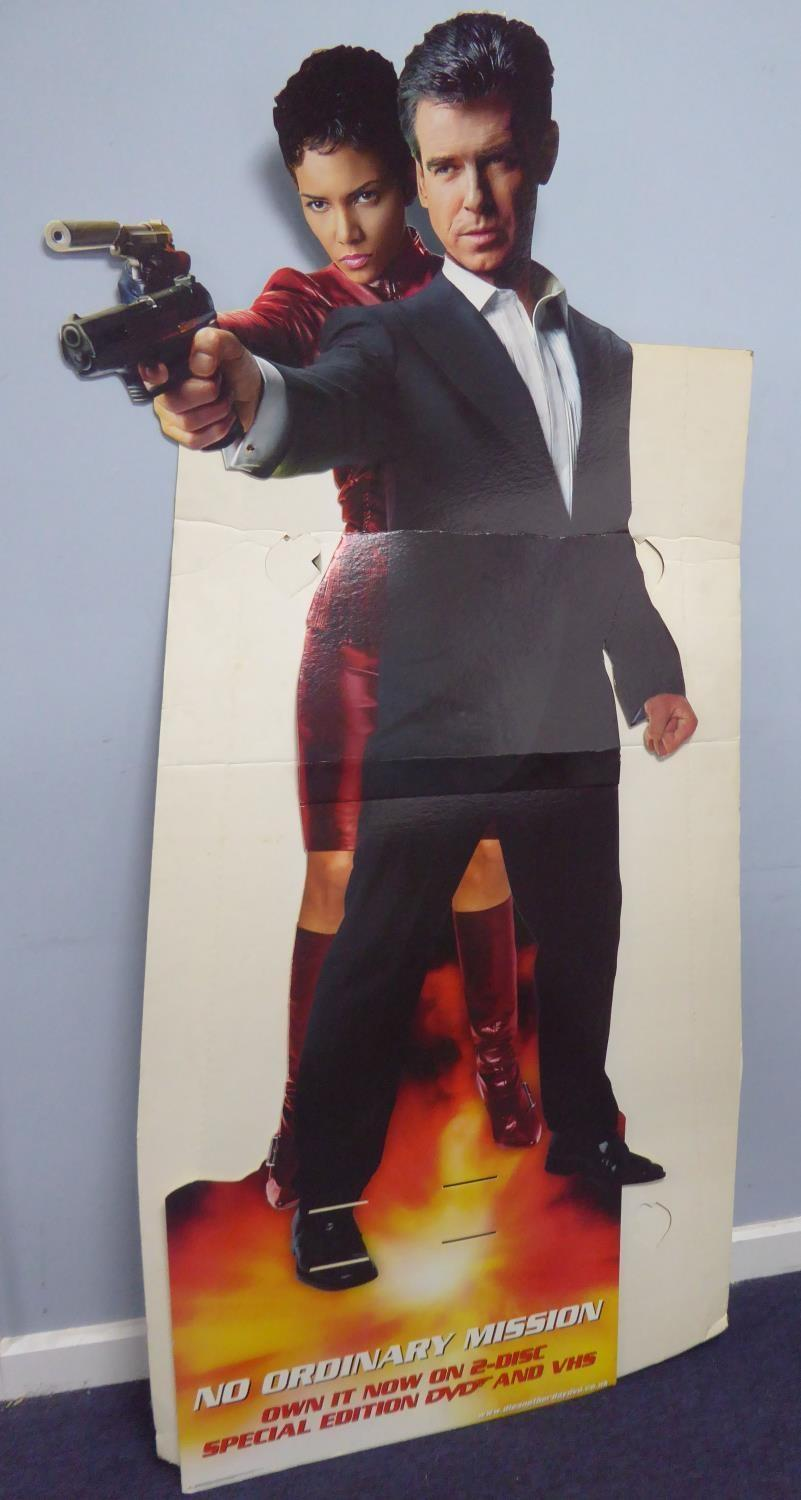 Lot 377 - JAMES BOND 'DIE ANOTHER DAY' COLOUR PRINTED CARDBOARD ADVERTISING STAND, featuring Pierce Brosnan