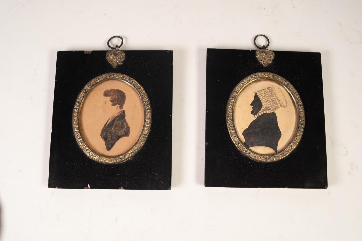 Lot 392 - PAIR OF NINETEENTH CENTURY PAINTED OVAL SILHOUETTE MINIATURES OF LADY AND GENTLEMAN, in contemporary
