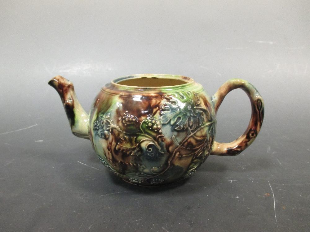 Lot 35 - A Whieldon type agate ware tea pot