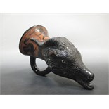Lot 19 - A late 19th century redware rhyton ramshead after the ancient Greek Attic Ware