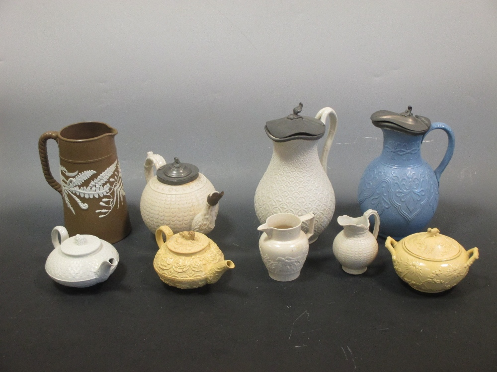 Lot 16 - Salt glazed stoneware and caneware by Copeland, Wedgwood et al., five jugs, three tea pots and a