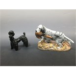 Lot 7 - A Doulton setter retrieving a cock pheasant, HN2529, together with a black pottery poodle