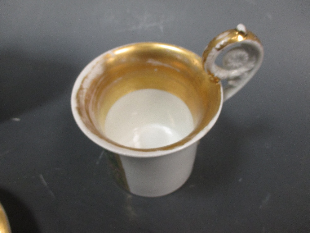 Lot 13 - A Berlin cabinet cup and saucer (restored) and a Meissen plate
