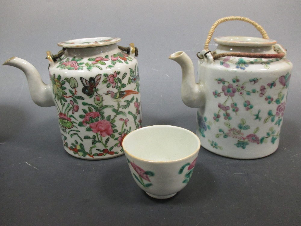 Lot 24 - A Chinese floral teapot and tea bowl, in original wicker basket case, late 19th century; and a