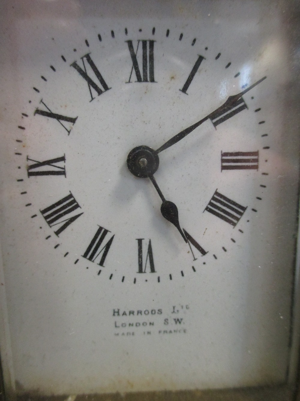 Lot 20 - An Edwardian Sheraton revival mantle clock; and a brass carriage clock retailed by Harrods (2)