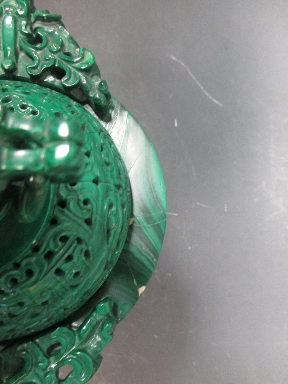 Lot 5 - A modern Chinese malachite three part vase with wood stand Bowl cracked and damaged to the rim