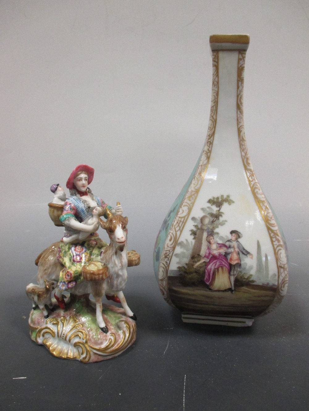 Lot 25 - A Thuringian bottle vase together with an Ernst Bohne group, 'The Tailor's Wife' (2)