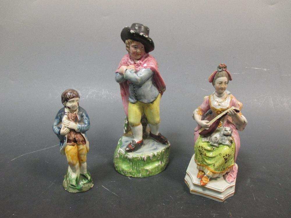 Lot 36 - Three mid 18th century pottery figures