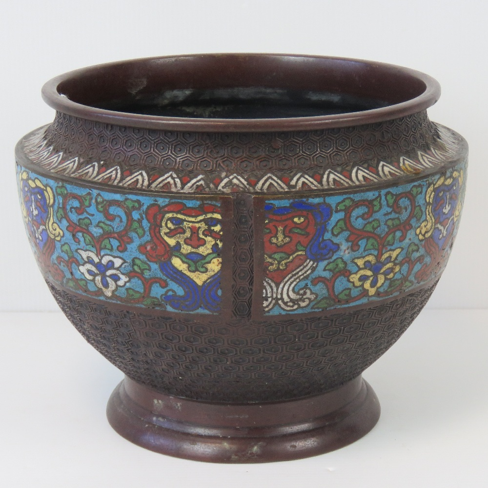 Lot 561 - A large bowl having three decorative clo
