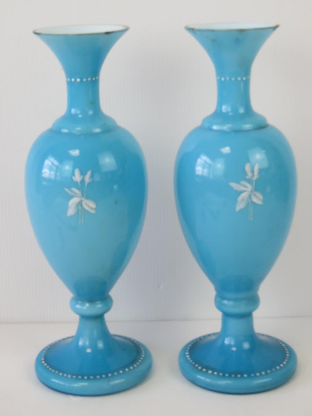 Lot 515 - A pair of blue white cased art glass vas