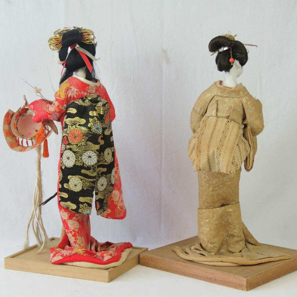 Lot 635 - Two 20th century Geisha girl free standi